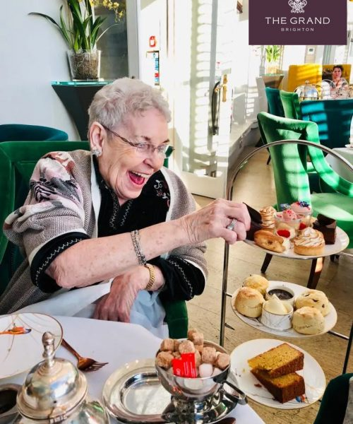 Jackie enjoying a cream tea at the Grand Hotel in Brighton
